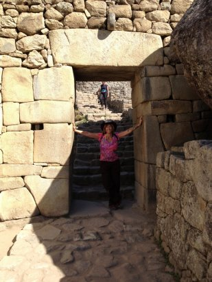Dani at an entrance in Machu Picchu